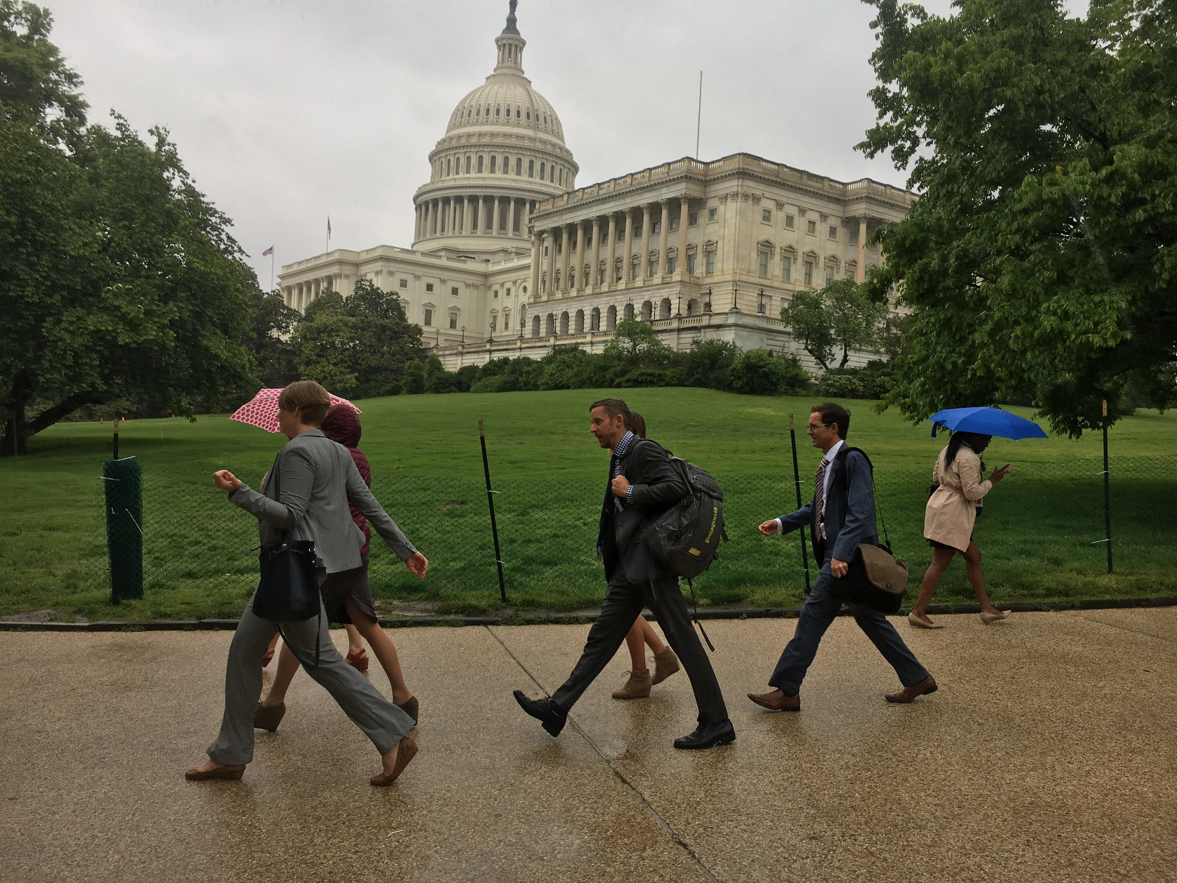 The delegation of Colorado climbers walks through the rain from the House to the Senate while lobbying Congress in Washington, DC, on May 11 as part of the Climb the Hill event organized by the Access Fund and American Alpine Club. [Photo] Derek Franz