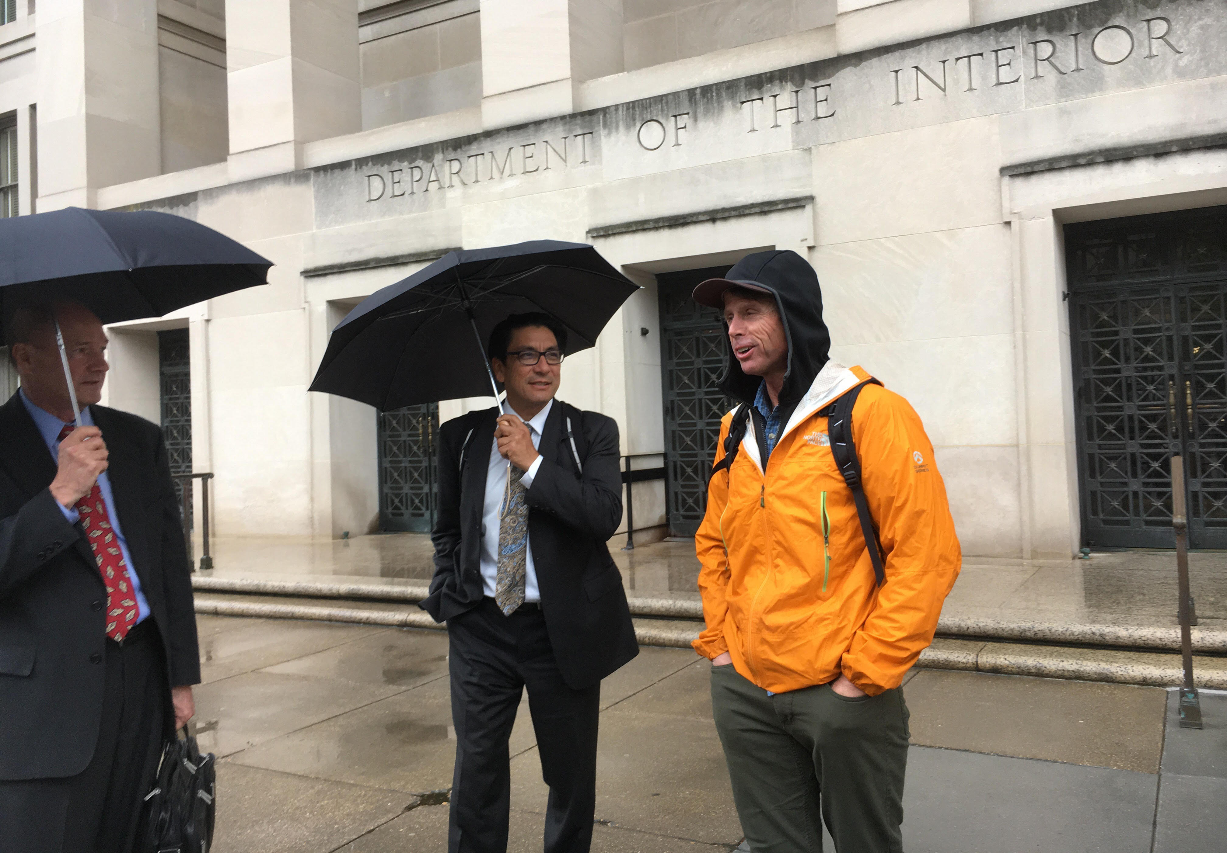 From left, Access Fund representatives Curt Shannon, Kenji Haroutunian and Peter Croft wait for a cab after meetings inside the Department of Interior. [Photo] Derek Franz