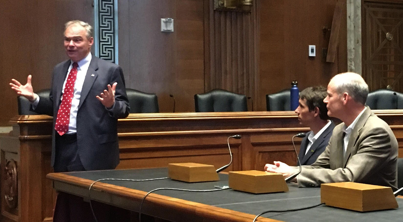 Senator Tim Kaine (D-Virginia) makes an impromptu speech at a Congressional briefing at the end of the day. Alex Honnold and Mike Gauthier, Yosemite National Park's Chief of Staff, look on. [Photo] Derek Franz