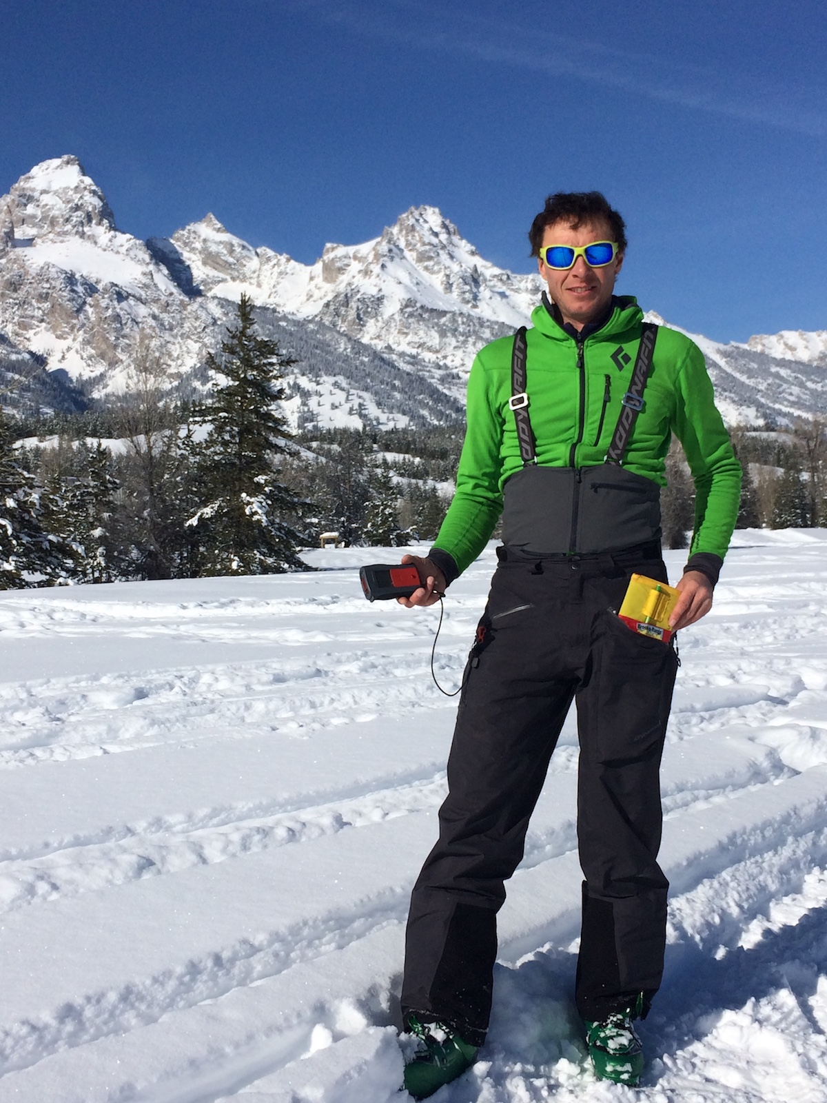 Mike Lewis demonstrates the compatibility of the Yotei Pants with an avalanche transceiver and field book during a trip to the Tetons in Wyoming. [Photo] Chris Brown
