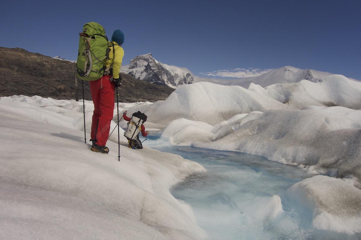 Matteo Della Bordella and David Bacci cross the 8 kilometer-wide Upsala Glacier with the east face of Cerro Murallon (ca. 2800m) in the background. [Photo] Matteo Bernasconi