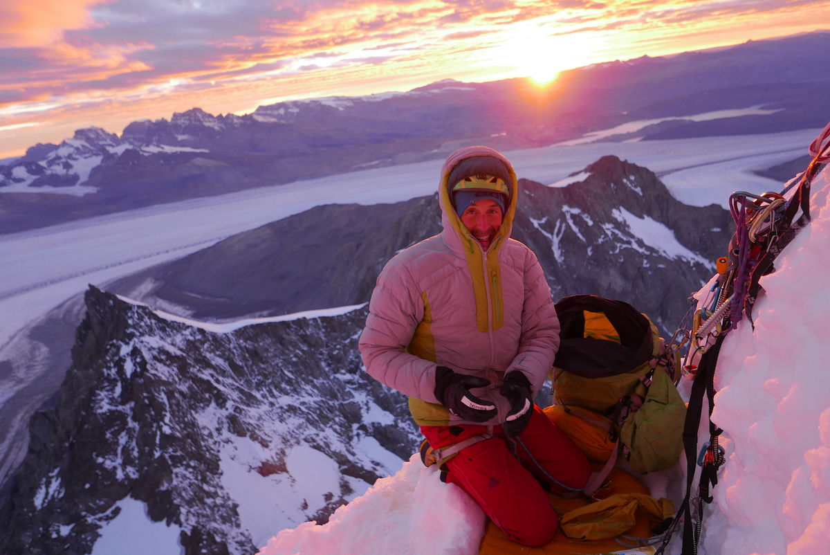 Bordella enjoys the first rays of sun after a cold bivy in the snow. [Photo] Matteo Bernasconi