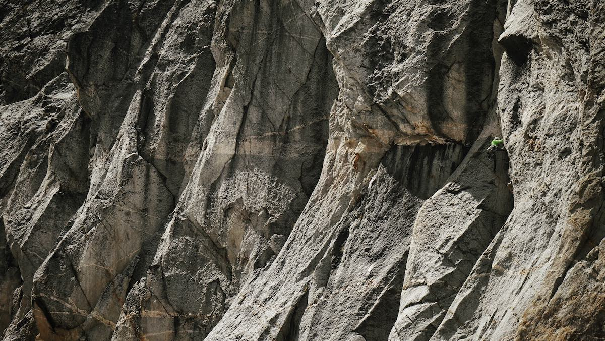 Morris climbs through the sea of granite on the East face of Hall Peak (9,975') during the first ascent of Heart Like A Hippo (5.10b, 800'). [Photo] Graham Zimmerman