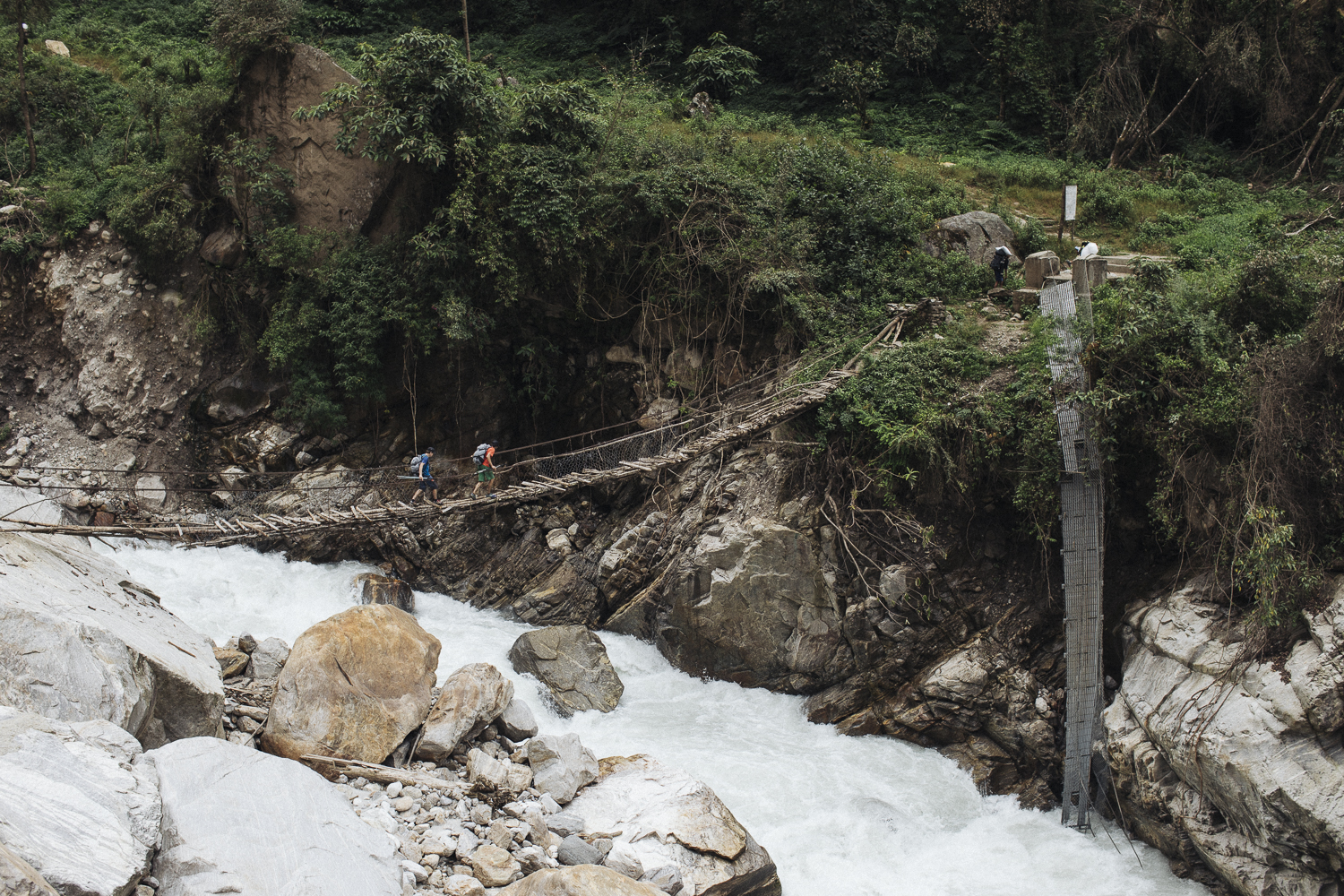 The long trek to base camp. The local people reinstalled the old bridge after the new one got swept away by a massive landslide just couple of weeks before during the heavy monsoon rain of [the 2016] season, wrote Hansjorg Auer. [Photo] Elias Holzkenecht