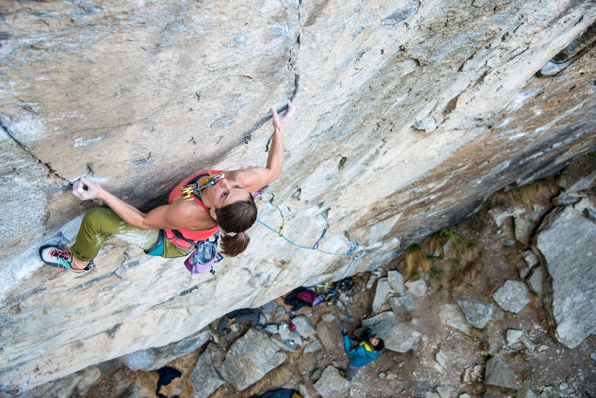 Barbara Zangerl carries a cam in her mouth to save energy for placing it during her greenpoint bid of Switzerland's Gondo Crack (5.14b R). The route was bolted 15 years ago and remained unclimbed until the end of March when Zangerl and her partner, Jacopo Larcher, did the first ascents using the bolts. In early April the two then sent the route using removable protection, skipping the bolts and risking huge falls from the crux. [Photo] Richard Felderer