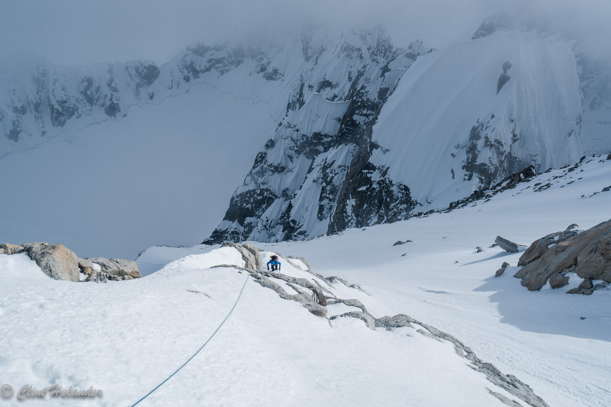 Roskelley races an incoming storm on the upper ridge. Idiot Peak is visible in the upper right. [Photo] Clint Helander