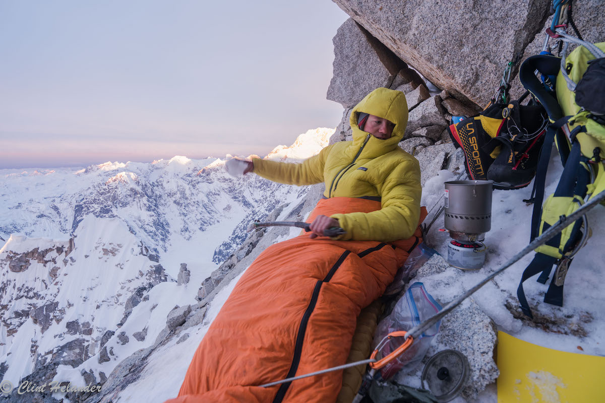 Roskelley settles in for a cramped bivy on Idiot Peak the night before summiting Huntington's South Ridge. [Photo] Clint Helander