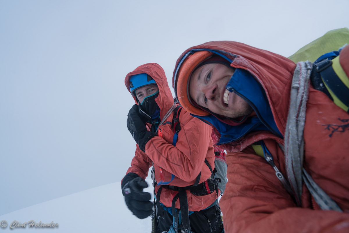 Roskelley and Helander on the summit after completing the five-day first ascent of the Complete South Ridge, which they dubbed Gauntlet Ridge. The two would spend the next 36 hours recovering and waiting for better weather to descend the mountain to base camp. [Photo] Clint Helander