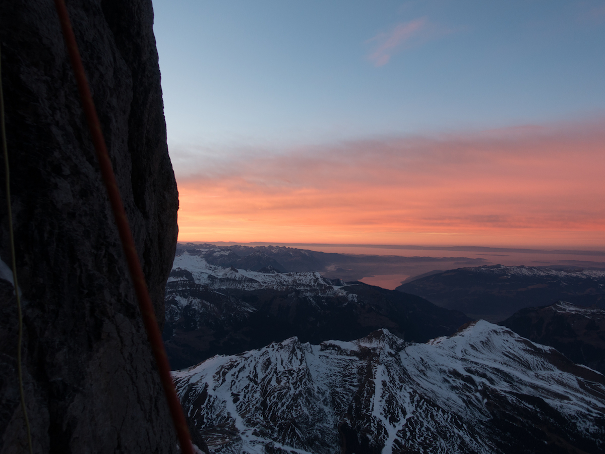 An evening view from the Eiger North Face in the direction of Lake Thun. [Photo] Archive Metanoia
