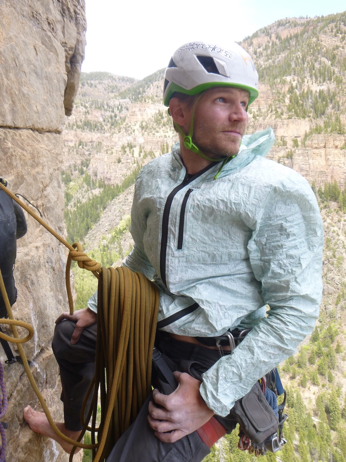 Derek Franz stays warm at a breezy belay with NW Alpine's Eyebright jacket atop Pitch 4 of Horse and Pony Show (III 5.11d) on the obscure Grizzly Creek Wall in Glenwood Canyon, Colorado. [Photo] Craig Helm