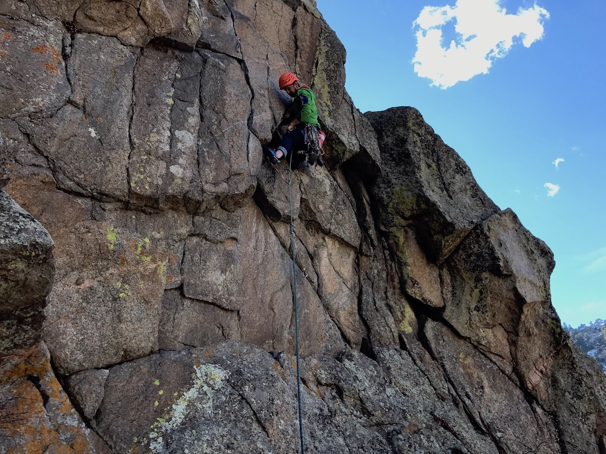 Chris Van Leuven leads FM (5.11c) in Boulder Canyon, Colorado, while wearing the Ortovox Merino Fleece Light Hoody. [Photo] Paul Gagner