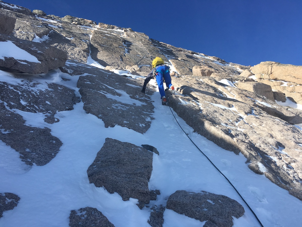 Mike Lewis guides the North Face of Longs Peak (14,259'), Rocky Mountain National Park, in mixed conditions. [Photo] Eric Stoutenburg