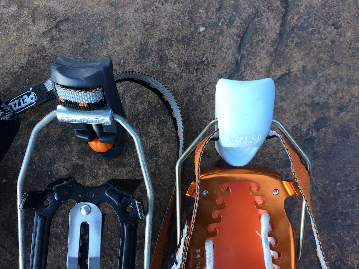 The Petzl Dart (left) and the Petzl Irvis Hybrid (right) have different heel levers. The Dart has a flatter, secondary edge that aids in housing the lever to a boot welt. This makes clipping the heel lever much easier than the Irvis Hybrid, which does not have the secondary edge. [Photo] Mike Lewis