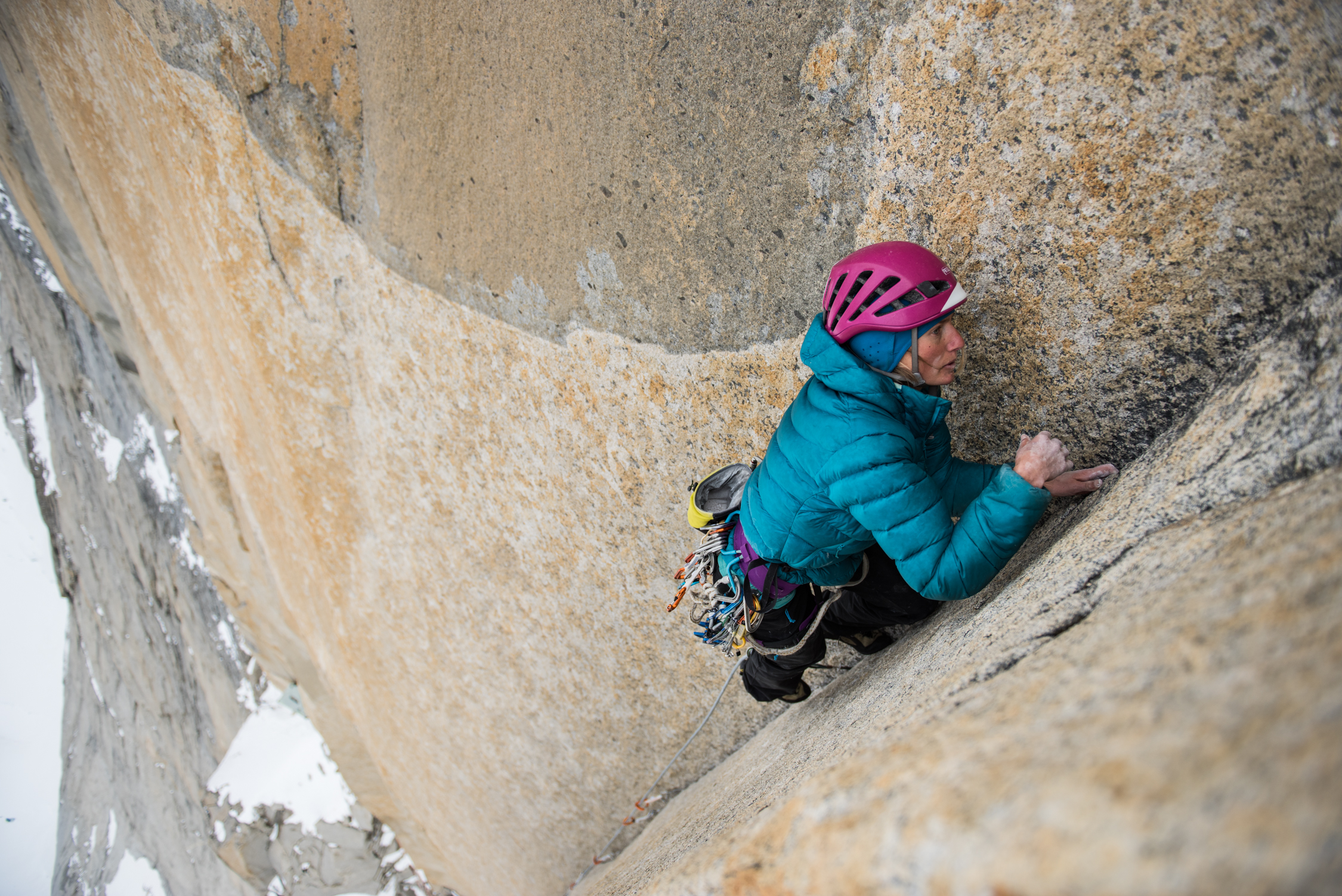 Brette Harrington leads a cold pitch on Riders on the Storm (VI 5.12d/5.13 A3, 1300m), Torre Central, Torres del Paine, Patagonia. [Photo] Drew Smith