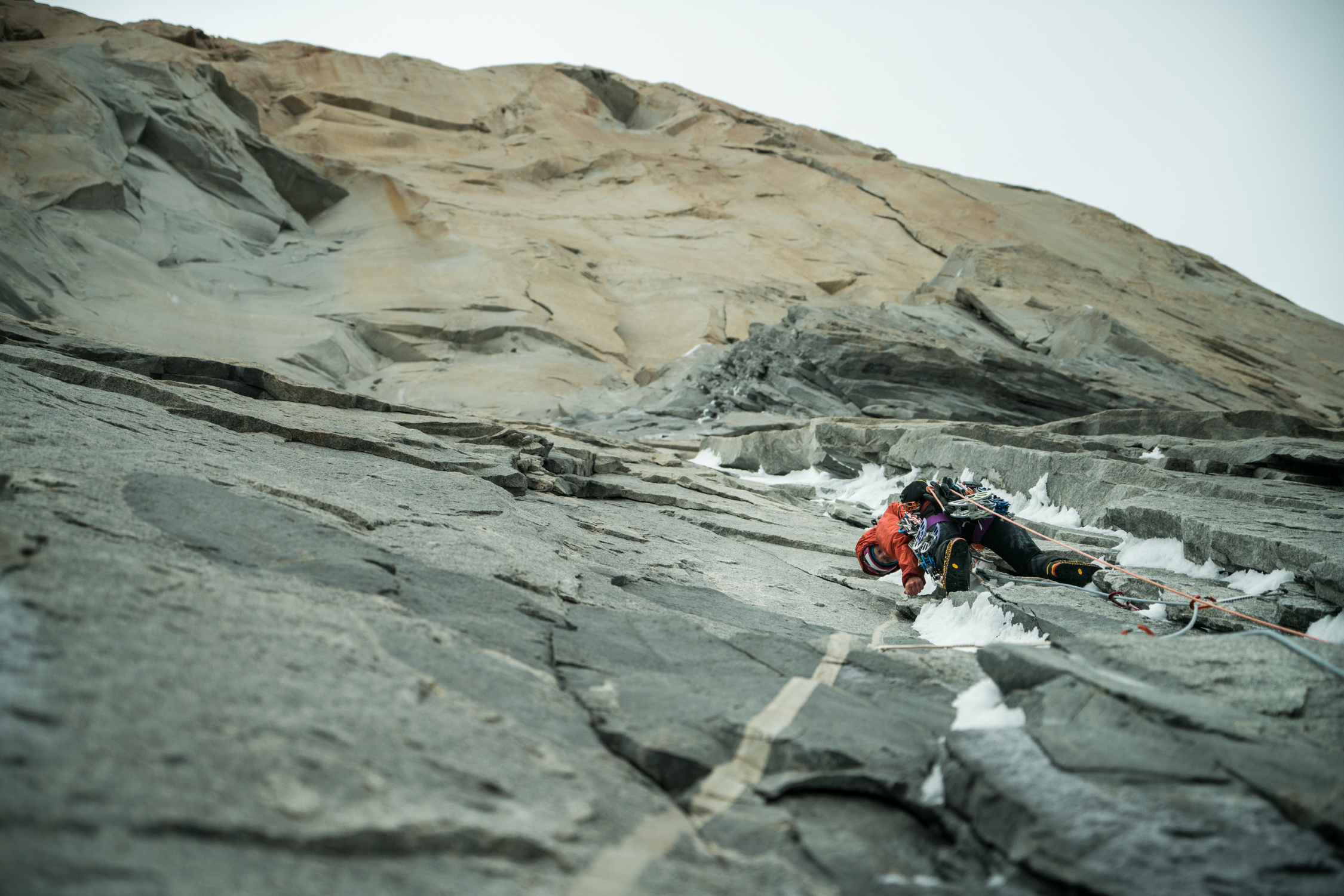 Brette Harrington leads an offwidth choked with ice and sugar snow in the vicinity of Pitch 9 on Riders on the Storm (VI 5.12d/5.13 A3, 1300m), Torre Central, Torres del Paine, Patagonia. She used a variety of tricks to make progress, including aid moves off her ice axes. [Photo] Drew Smith