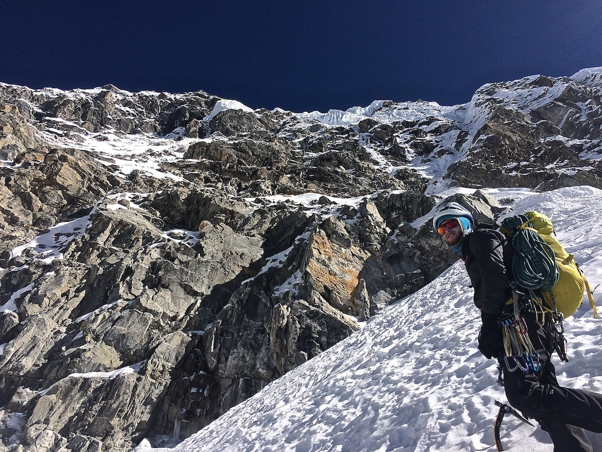 Mirhashemi stands below the west face of Chugimago on the way down from another successful ascent. [Photo] Mark Pugliese