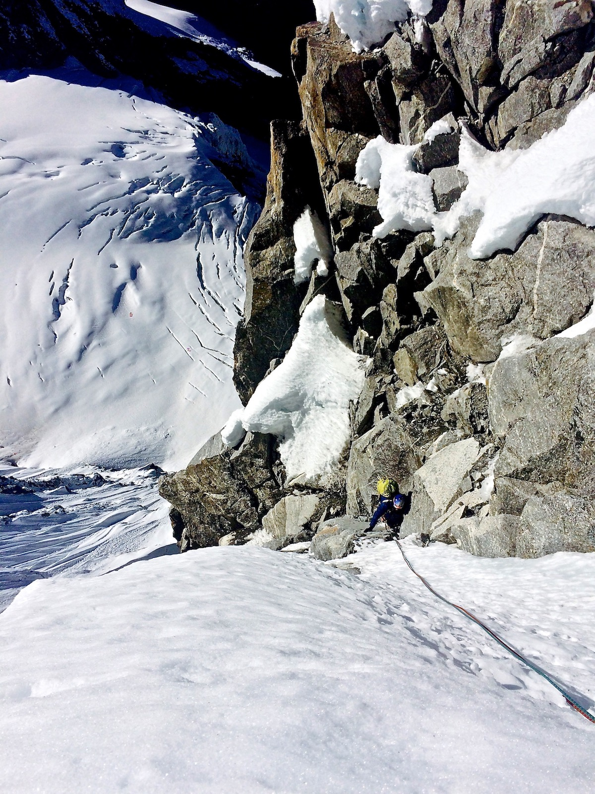 Mirhashemi follows one of the M5 pitches on the headwall of Chugimago's west face during the first ascent of Mixed Emotions (M6 AI5, 80 degrees, 900m). [Photo] Mark Pugliese