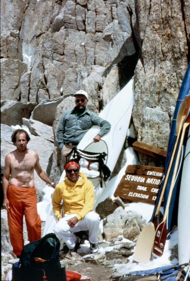 Reg Lake, Robbins and Doug Tompkins take a break from schlepping their kayaks at the top of the 13,777-foot pass on Mt. Whitney en route to the headwaters of the Kern. [Photo] Reg Lake collection
