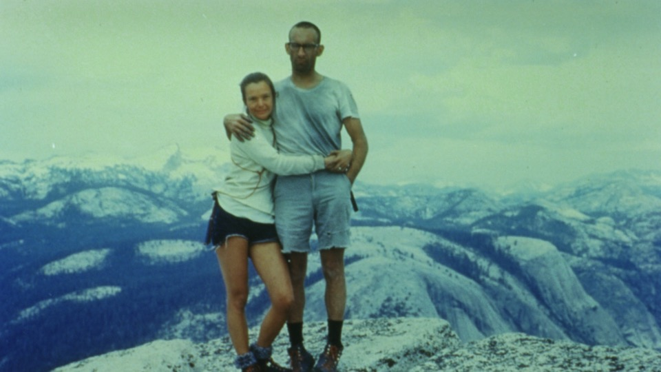 Royal and Liz Robbins on top of Half Dome after Liz became the world's first woman to climb the Northwest Face, June 1967. It was the tenth anniversary of Royal's first ascent of the wall. Liz said that they got the idea to start a clothing company for climbers after they saw how ragged they looked in this photo. [Photo] Robbins family collection