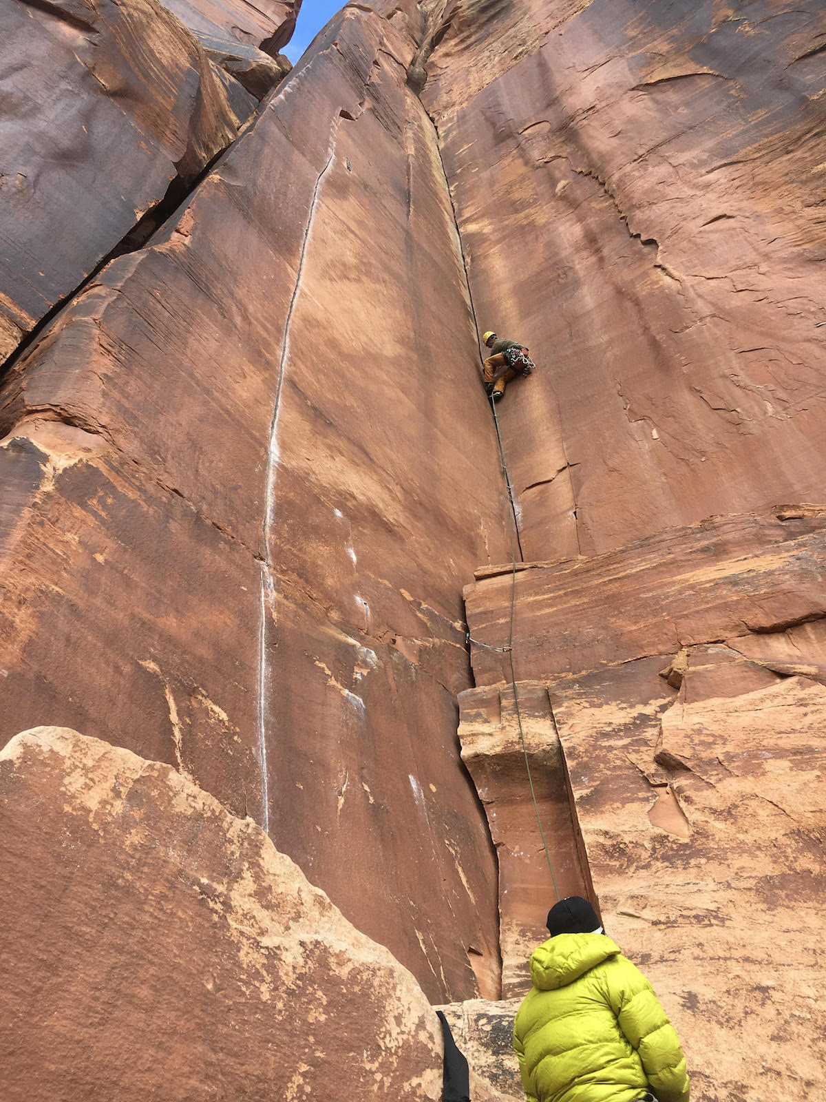 A climber leads Three Strikes You're Out (5.11, 90') on the Battle of the Bulge Buttress in Indian Creek, Utah. The area is part of Bears Ears National Monument where US Interior Secretary Ryan Zinke is conducting a visit as part of his review of all national monuments designated in the last 21 years—as ordered by President Donald Trump in April. Conservation groups fear the unprecedented review could result in these monuments being rescinded or reduced. [Photo] Derek Franz