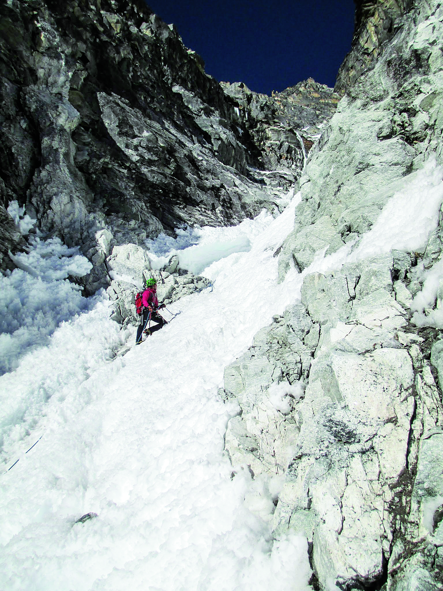 Anna Pfaff leads up the couloir on Lungaretse, Marlung Valley, Nepal. [Photo] Camilo Lopez