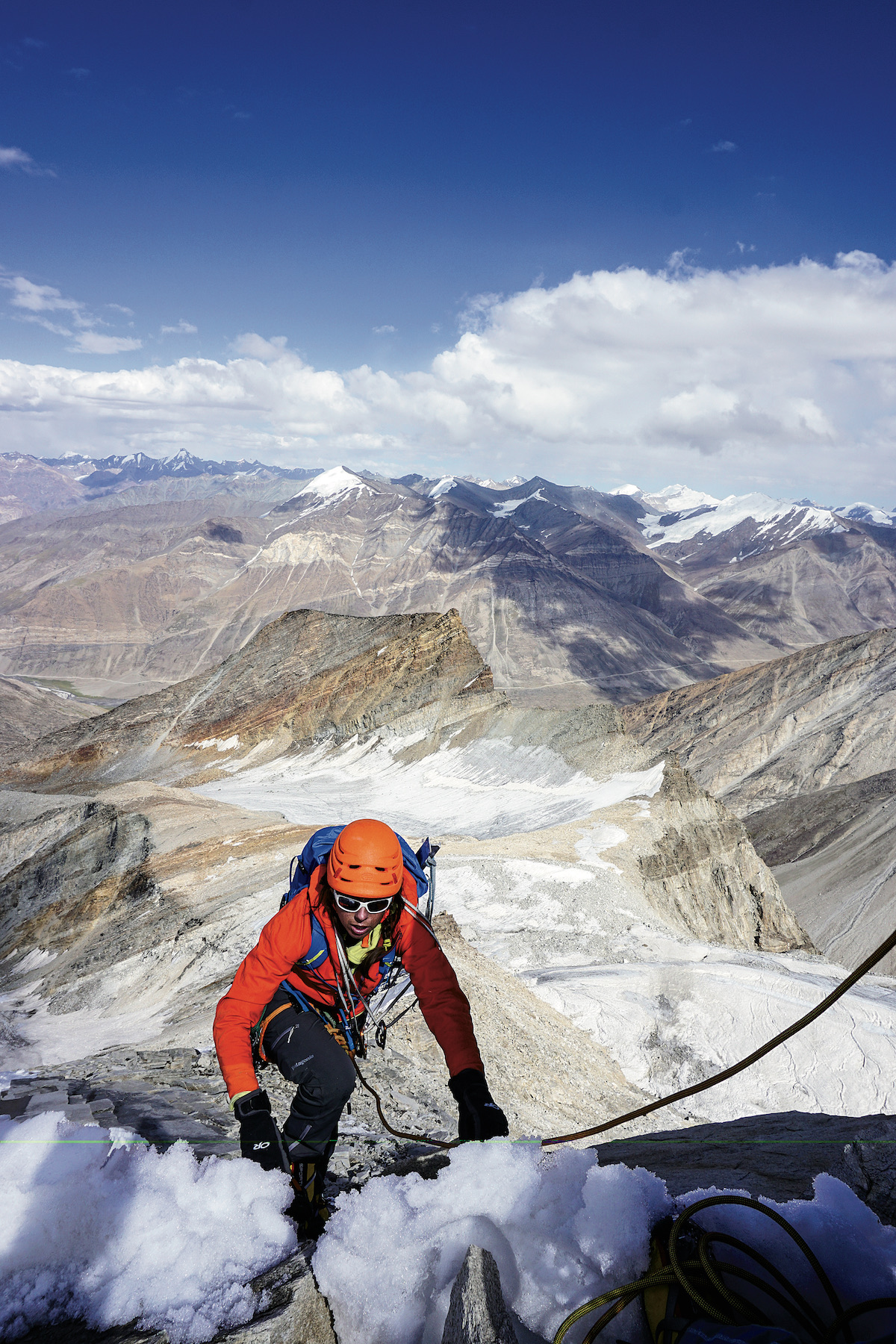 Rachel Spitzer below the summit ridge of Tare Parvat (5577m), Zanskar, India. Spitzer, Lisa Van Sciver and Pfaff named their route Unattached (5.6 WI3 AI4 M4, 600m, 2015). In the 2009 Himalayan Journal, Indian explorer Harish Kapadia described how each bend in the road in Zanskar reveals another unclimbed face. Sip wine at one valley, climb and move on to the next one to open another bottle, he recommended. [Photo] Anna Pfaff