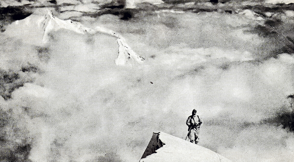 Janusz Klarner arrives on the summit snowfield of Nanda Devi East in 1939. Nanda Kot is visible in the background. [Photo] Jakub Bujak collection