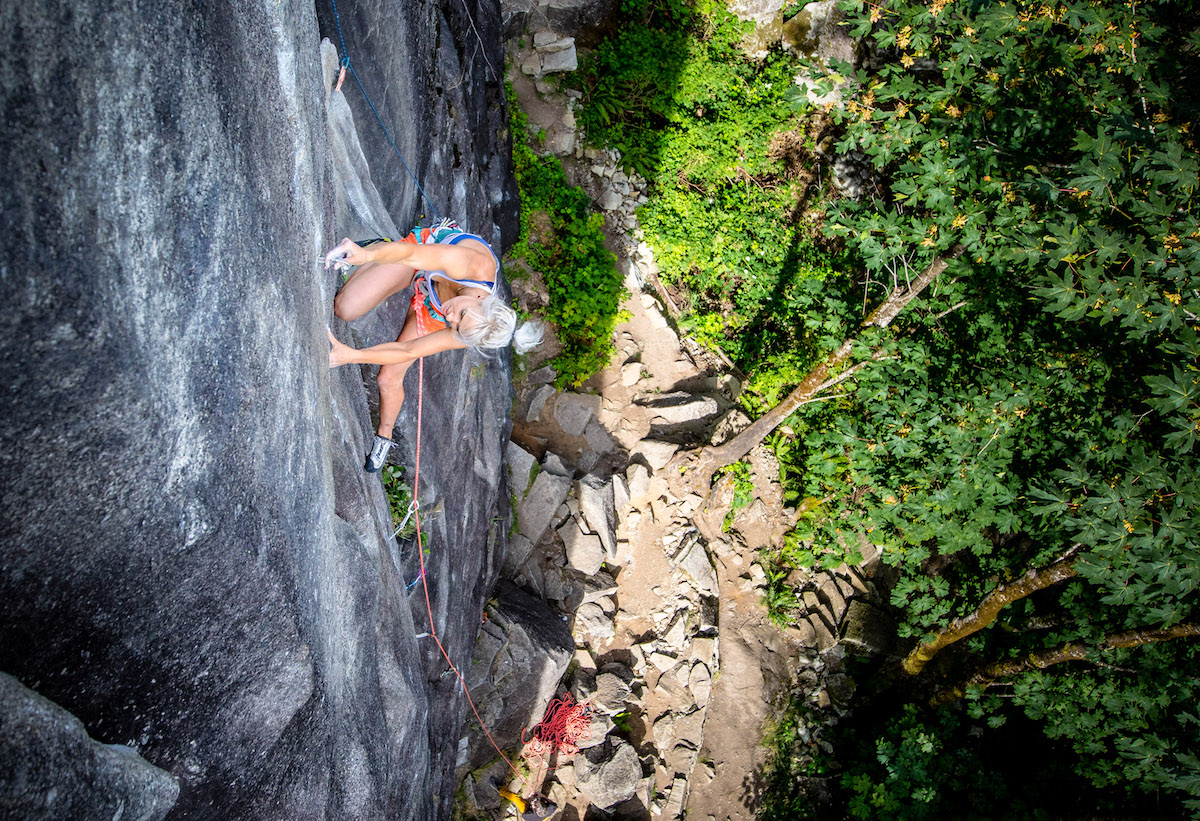 Brittany Goris plugs small gear on the 5.13c/d pitch of City Park, Index, Washington. [Photo] Truc Allen