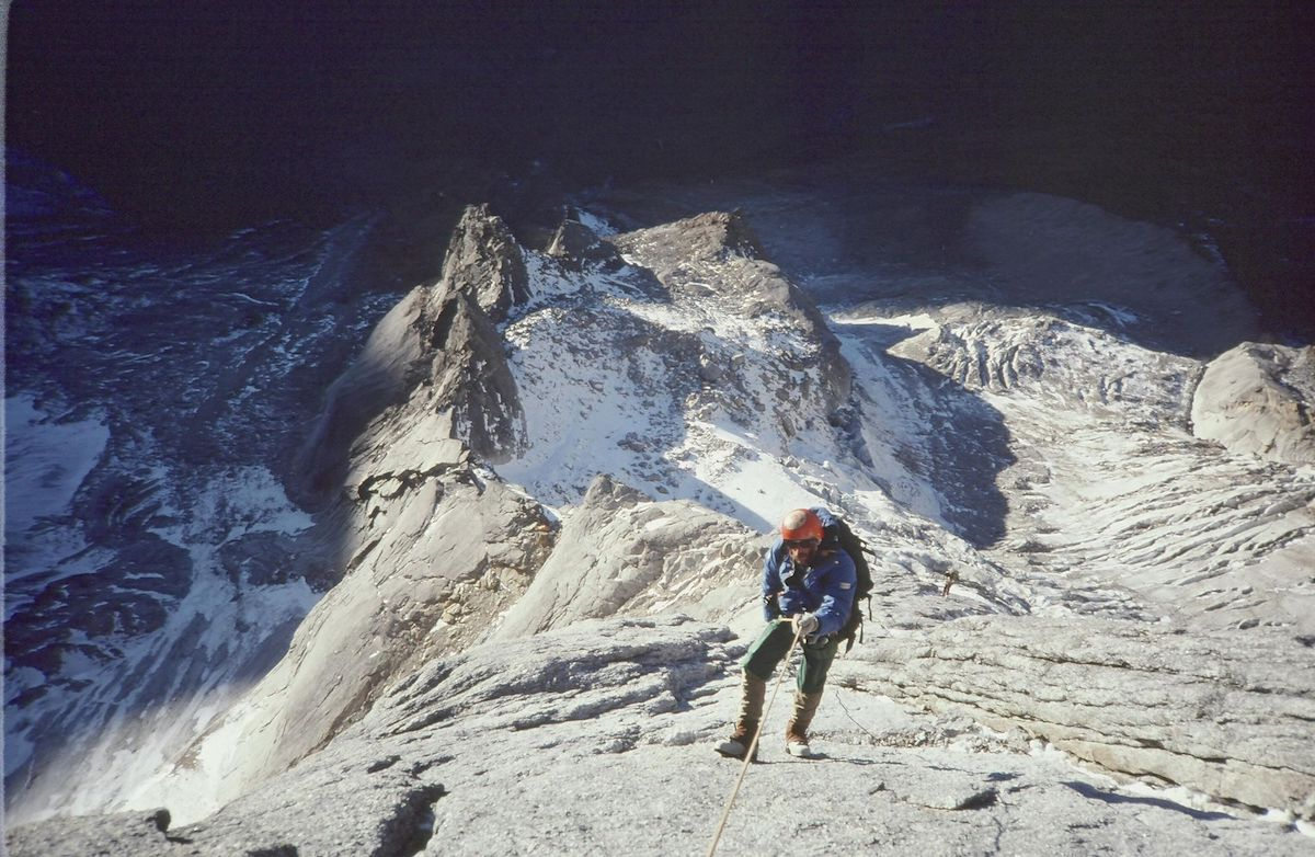 Jim Kanzler rappelling off the north face of Mt Siguniang. [Photo] Jack Tackle, Kim Schmitz collection