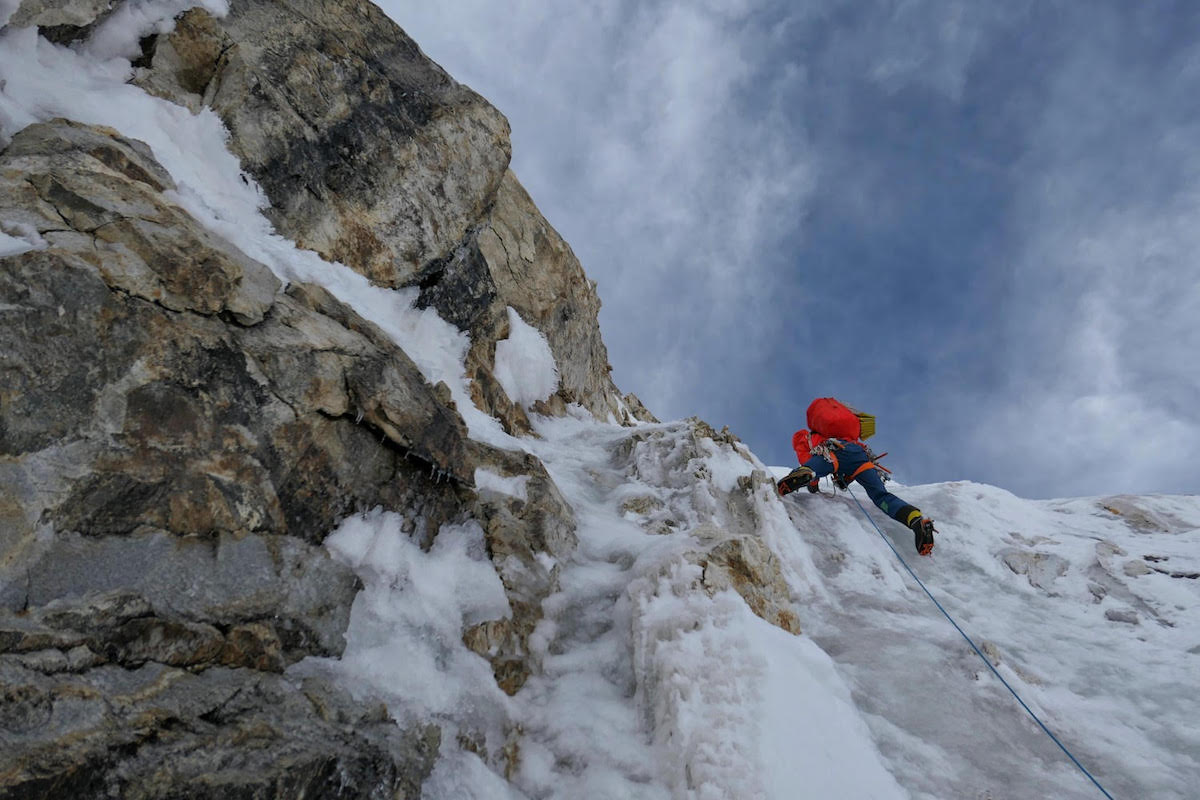 Tom Livingstone leading on Latok I during his successful ascent from the north side in which he and Ales Cesen and Luka Strazar climbed three-quarters of the North Ridge before traversing right to reach the south face where they continued to the top. [Photo] Ales Cesen/Luka Strazar