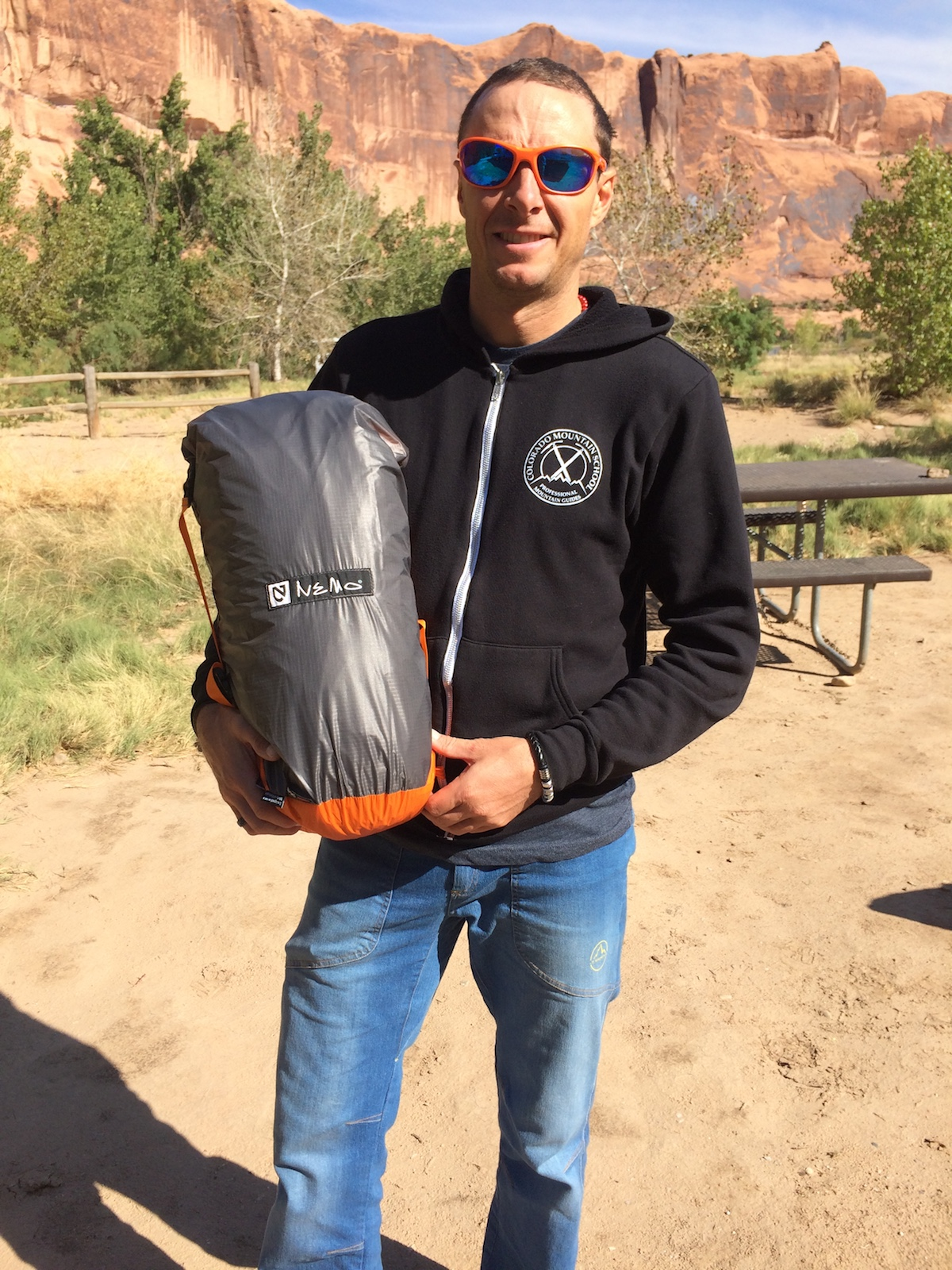 Mike Lewis holds the Nemo Chogori 3-person Mountaineering tent in its compression stuff sack. [Photo] Chris Wood