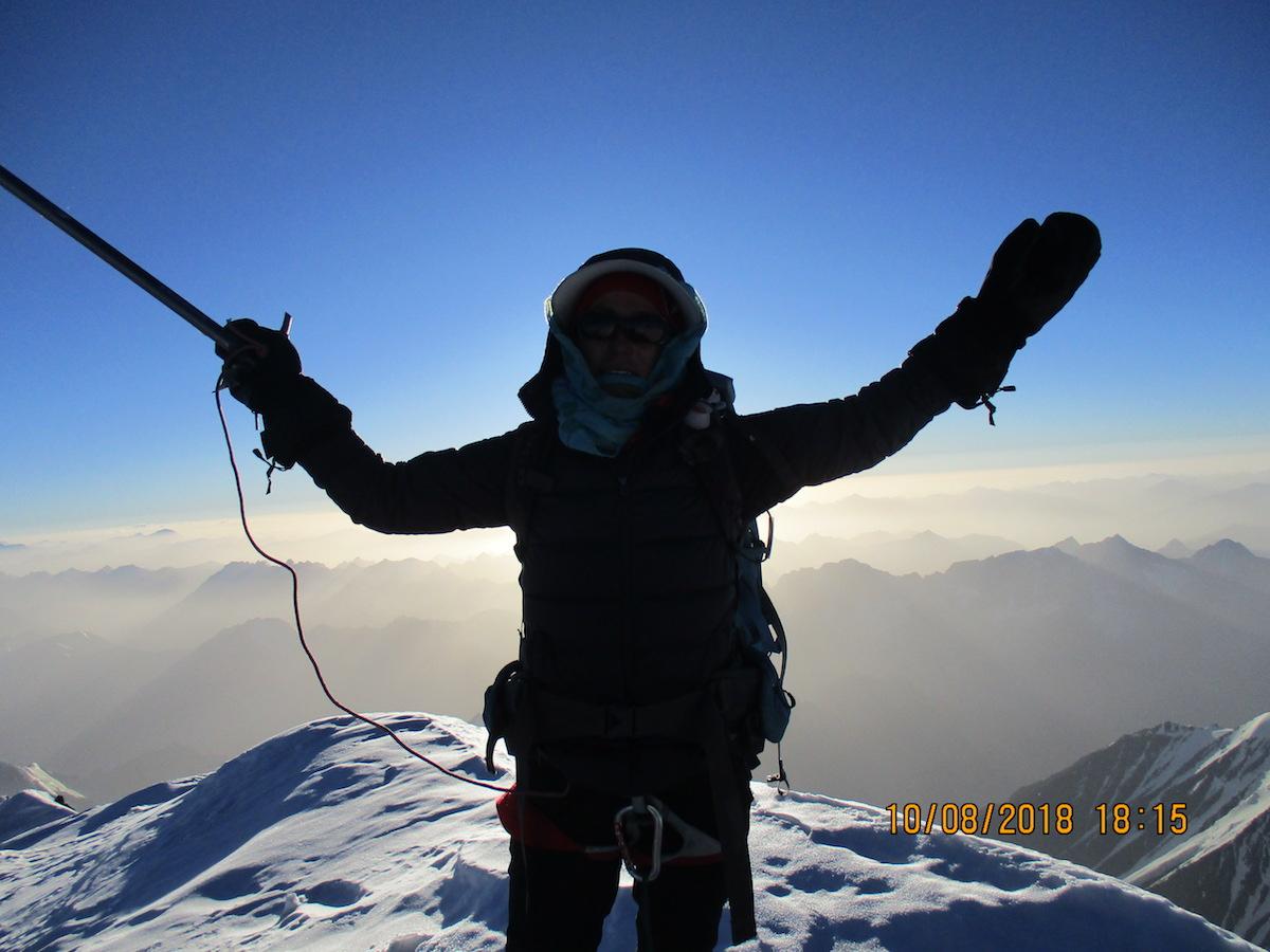 Yousoufi on top of Noshaq. [Photo] Courtesy of the Ascend: Leadership through Athletics Program