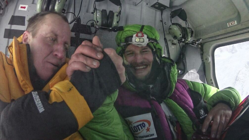 Urubko and Bielecki in the helicopter after the rescue. [Photo] Courtesy of Denis Urubko