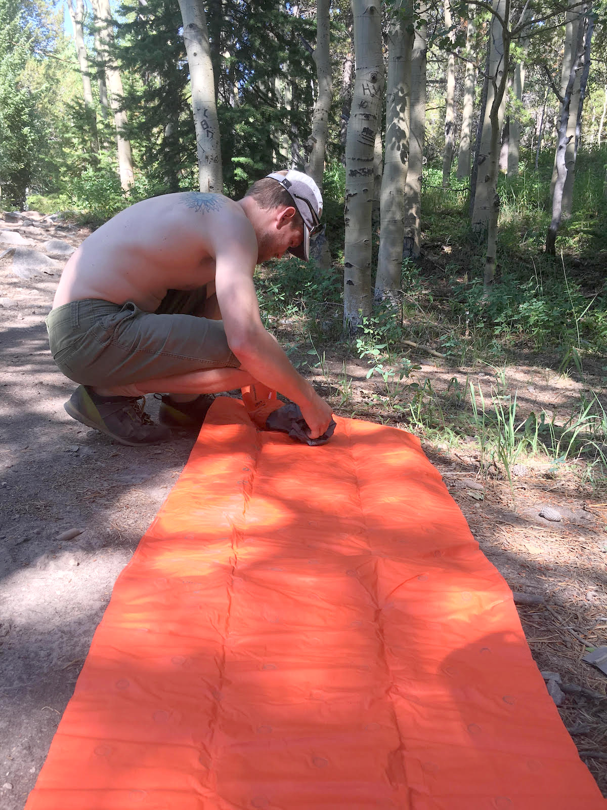 The author setting up the pump sack for the Sea to Summit Ultralight Air Mat. After a small amount of practice, three pumps are plenty to inflate the mattress. [Photo] Amanda Franz