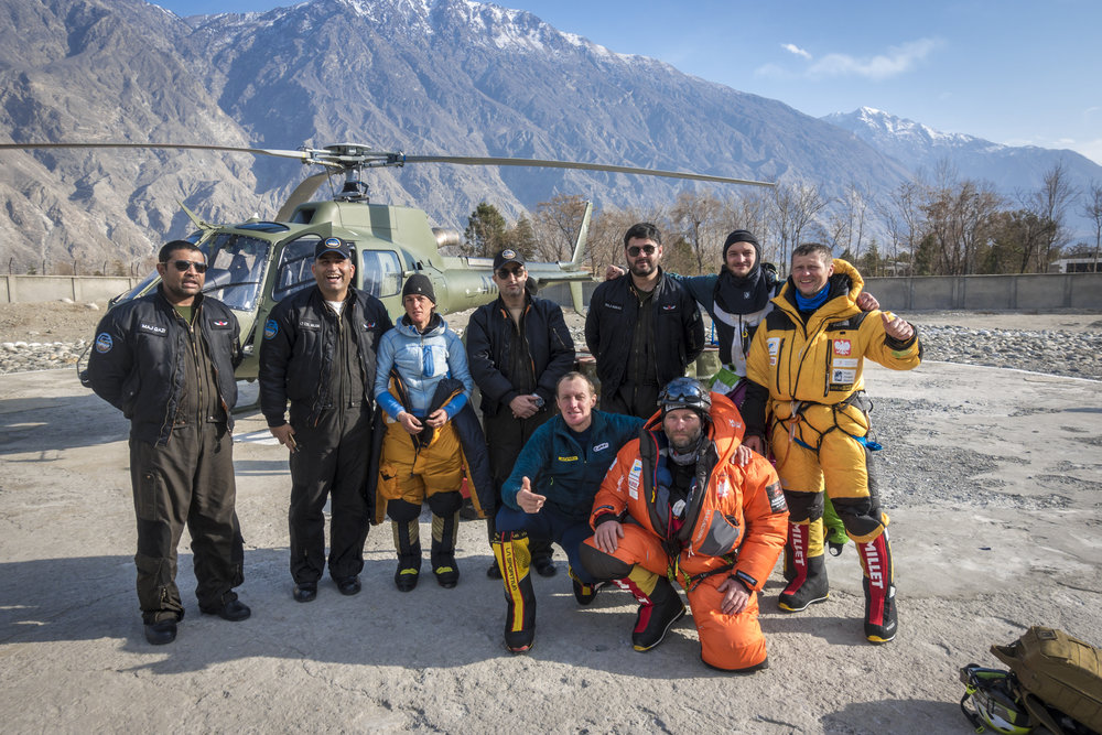 Dennis Urubko, Adam Bielecki, Jaroslaw Botor and Piotrek Tomala with Elizabeth Revol and the Askari Aviation pilots after the rescue on Nanga Parbat. [Photo] Piotrek Tomala, courtesy of the American Alpine Club