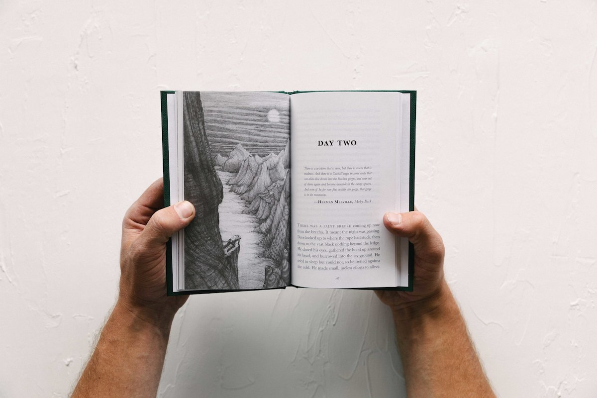 As Above, So Below is a hand-size hardback book with illustrations by Craig Muderlak. [Photo] Jimena Peck