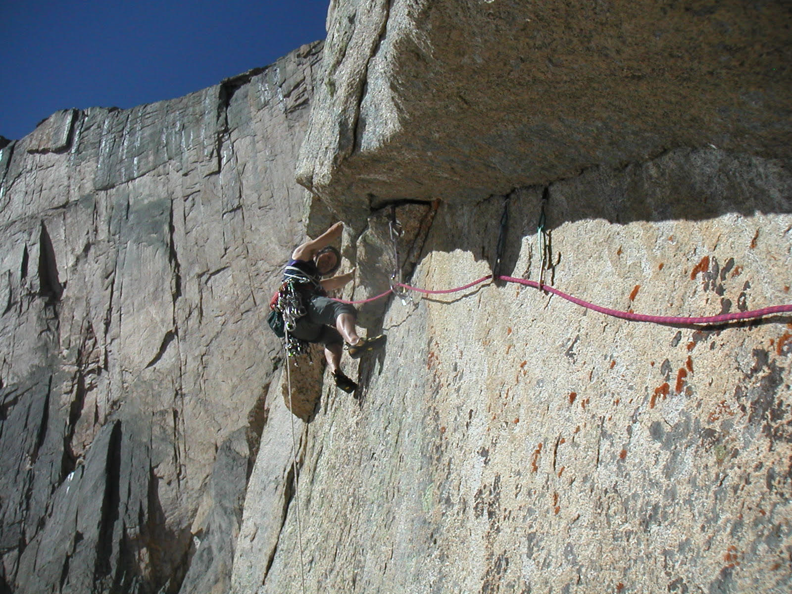Chip Chace on Invisible Wall (IV 5.12a, 500'), Longs Peak. [Photo] Roger Briggs