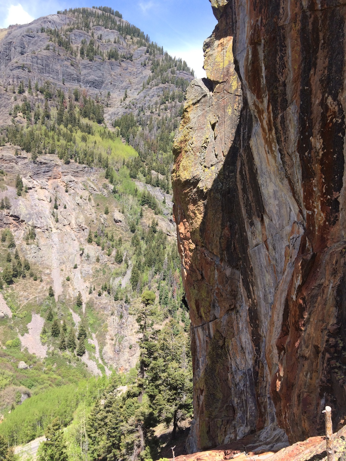 The Foehn Brise Pants were ideal for the chilly spring temps at the Techno Crag (ca. 9,000') above Ouray, Colorado, last May. Here the author enjoys the classic arete of All Night Rave (5.12b) with numb fingers. [Photo] Mandi Franz
