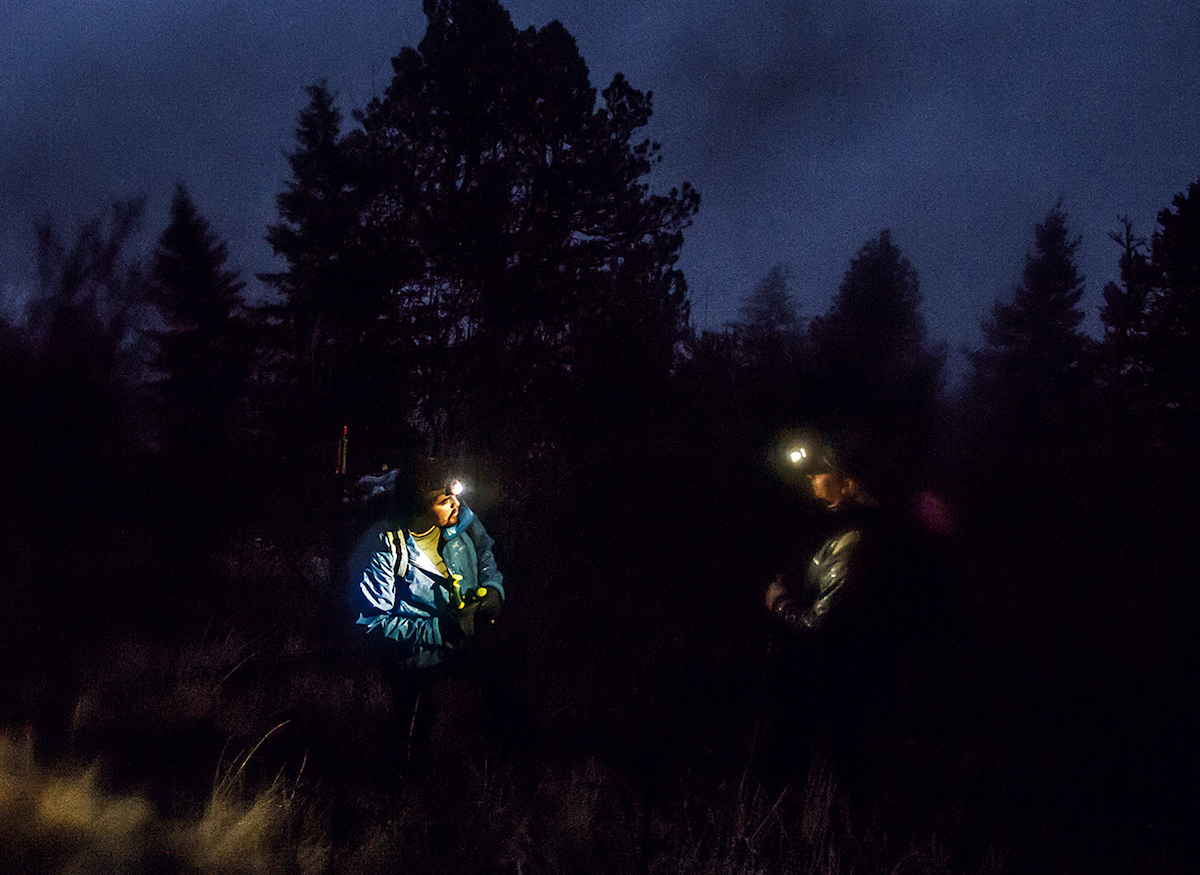 Necefer and Moses-Conner in deep discussion as darkness falls on Doug Peak. [Photo] Joe Whittle
