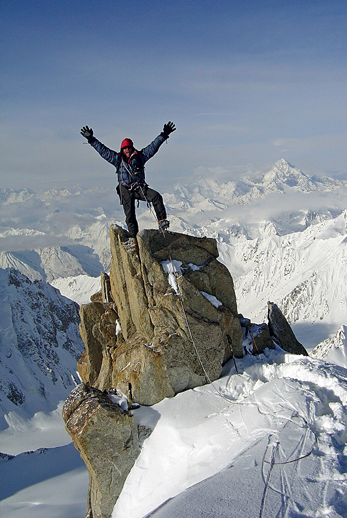 Mark Jenkins on the summit of Koh-e-Bardar, looking west to the Wakhan Corridor. [Photo] Doug Chabot