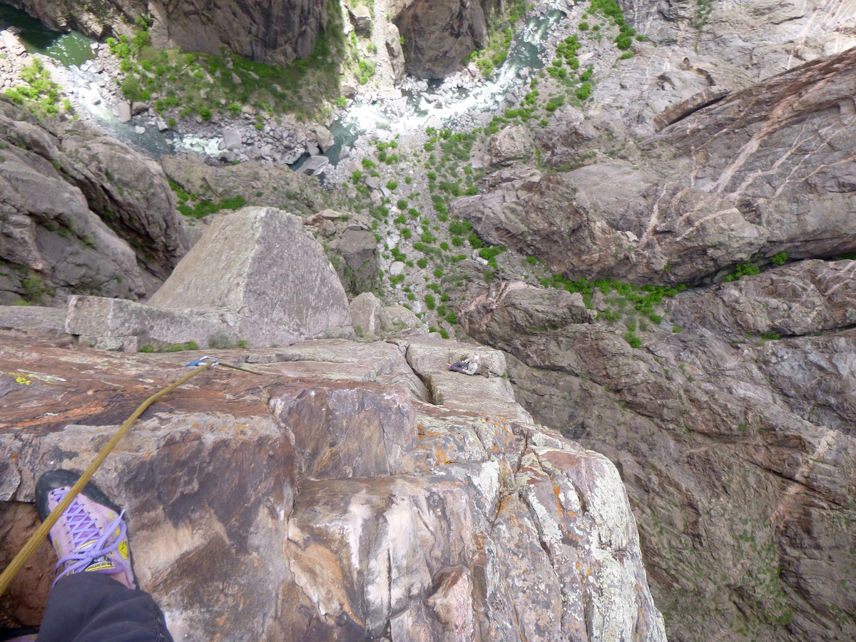 Morgan Williams enjoys a belay ledge on Modern Day Migs (III 5.10d, 7 pitches), Black Canyon of the Gunnison National Park. [Photo] Derek Franz