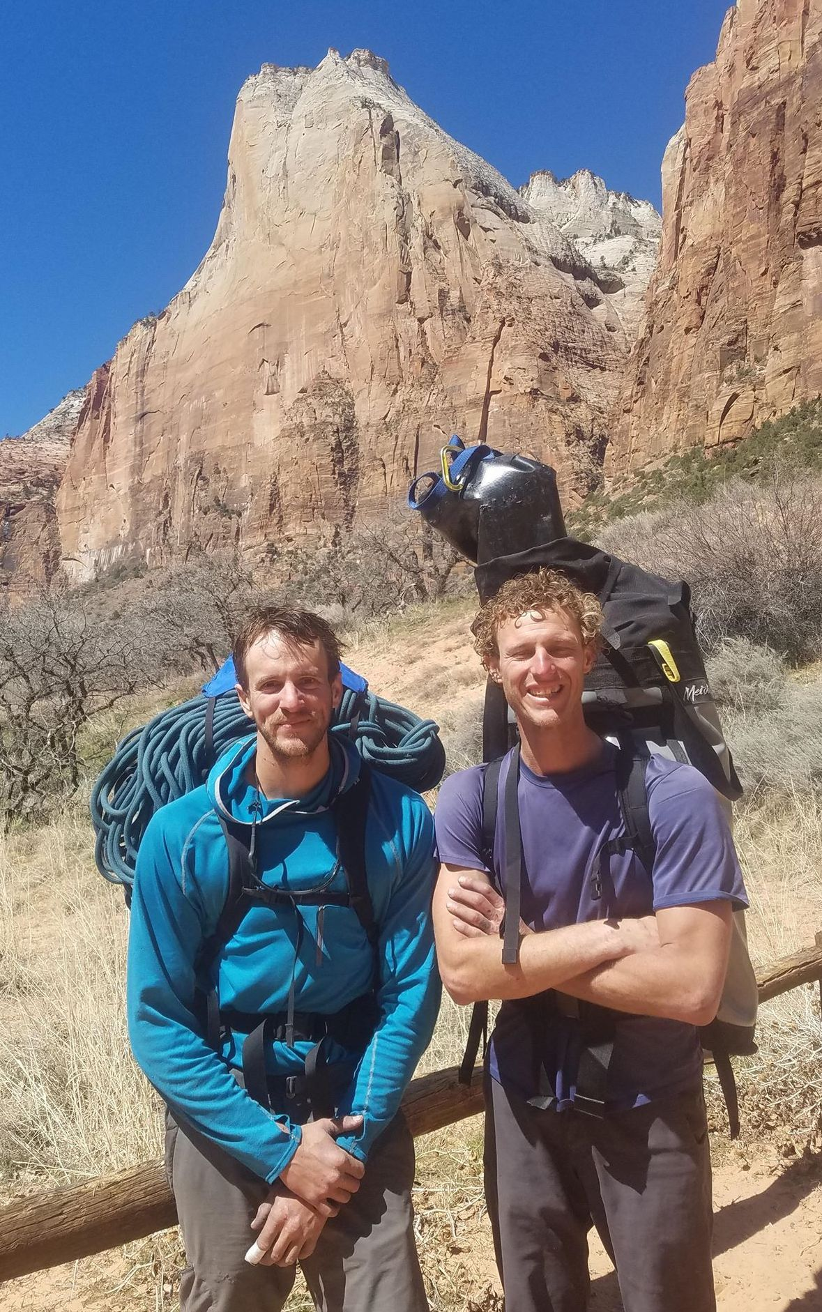 Brandon Adams, left, and Roger Putnam in Zion after the first ascent of Pangea (VI 5.10 A4) on Abraham (visible in the background), March 2018. [Photo] Roger Putnam collection