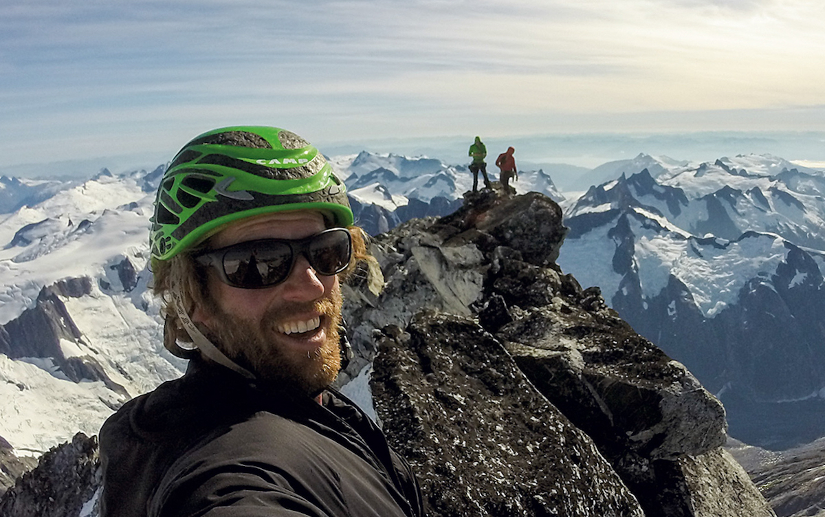 Taylor on the summit with Mike and Tyler. As Klose told Alpinist, it was the first time that two parties shared the summit. [Photo] Cole Taylor