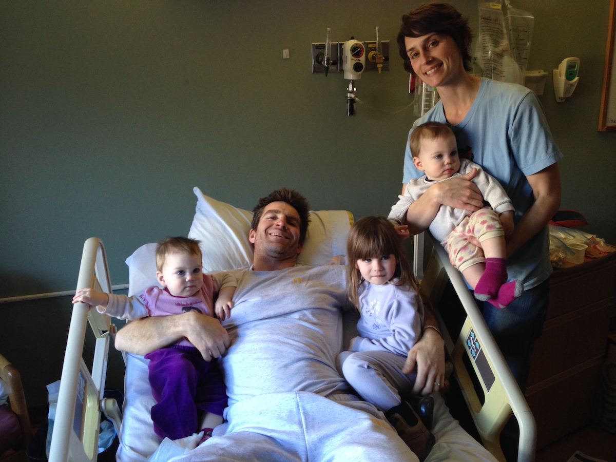 Alex McKiernan in the hospital with his family four days after the car crash. I have no memory of this, he said. [Photo] Alex McKiernan collection