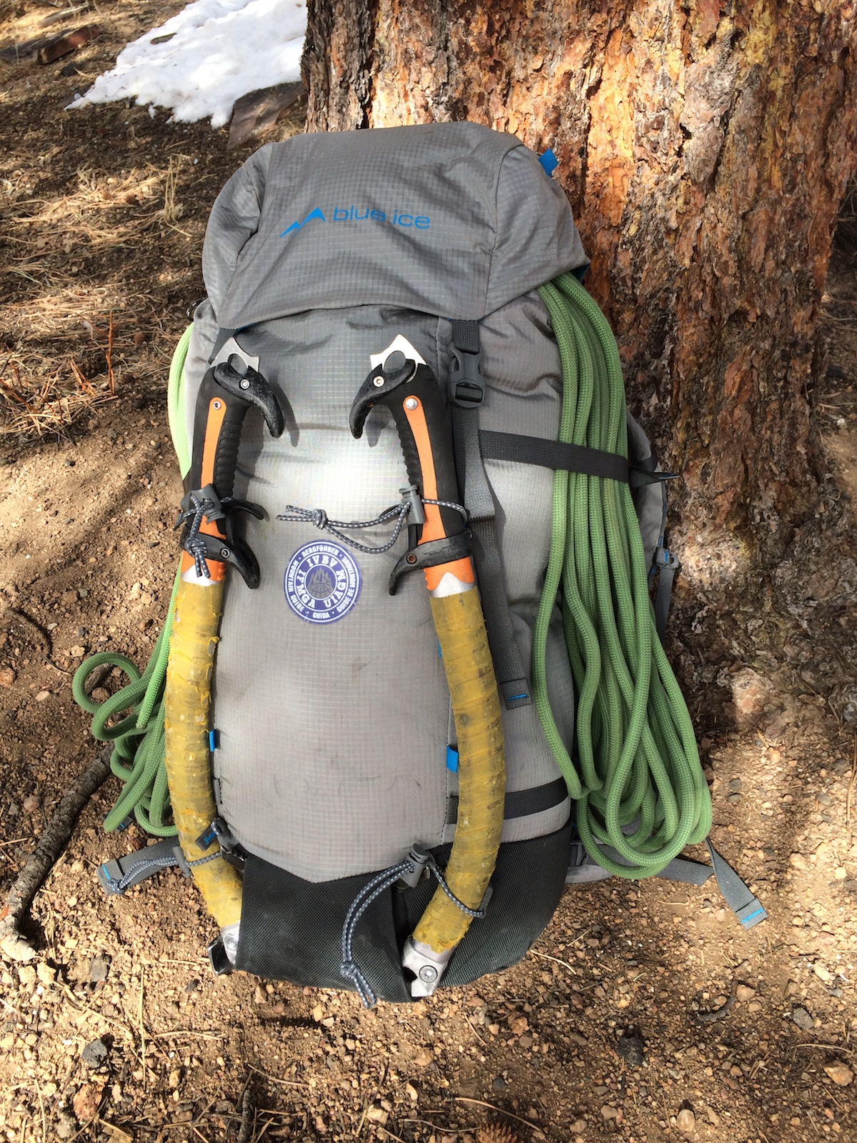 The Yeti 50L pack shown carrying two ice tools and a rope. The ice tools are held by bungee cords with plastic toggles. [Photo] Mike Lewis