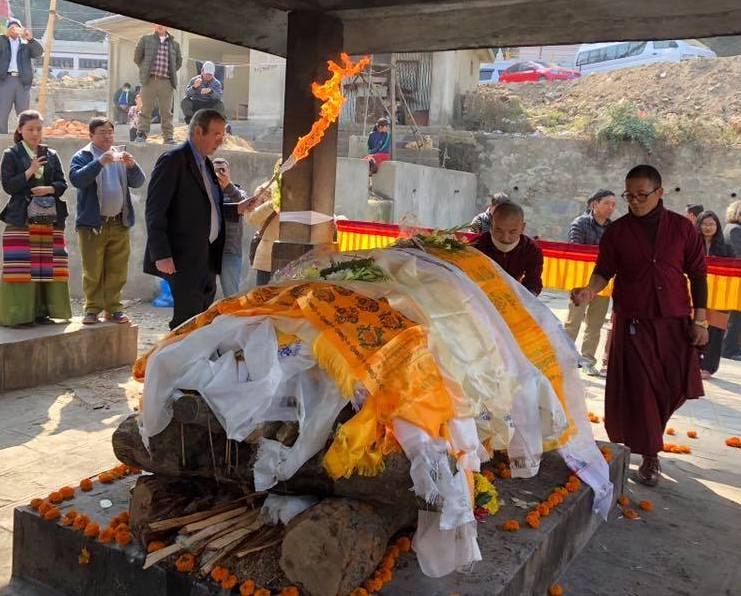 Elizabeth Hawley's nephew Michael Hawley Leonard lights her funeral pyre in Nepal. [Photo] Meg Leonard