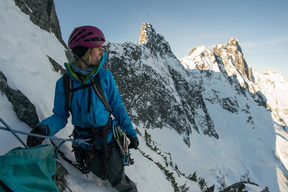 Brette Harrington on Labour Day Horn, one of Mt. Slesse's satellite peaks. On Instagram, her partner Kieran Brownie wrote, We topped out early and decided to traverse the ridge to take a look at Station D (the peak just over Brette's shoulder). We reached the summit in the blue hues of dusk to find a stunning view of the Cascades; a sprawling vista of pristine mountains, a place where the imagination can run free. [Photo] Kieran Brownie