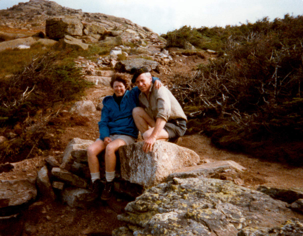 Laura and Guy Waterman are pictured here on the Franconia Ridge in New England's Presidential Range during the mid-1980s, when they were very involved with trail work under the Appalachian Mountain Club's adopt-a-trail program. We and some of our trail work friends had recently placed those rocks at the head of Walker Ravine in an attempt to reinforce the drainage and stabilize the trail, she told Alpinist. [Photo] Waterman family collection