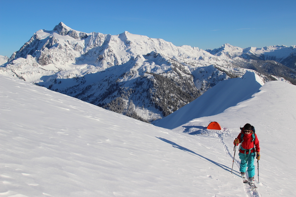 Skinning on Ptarmigan Ridge with Mt. Shuksan and Mt. Baker in the background. [Photo] Tim Black