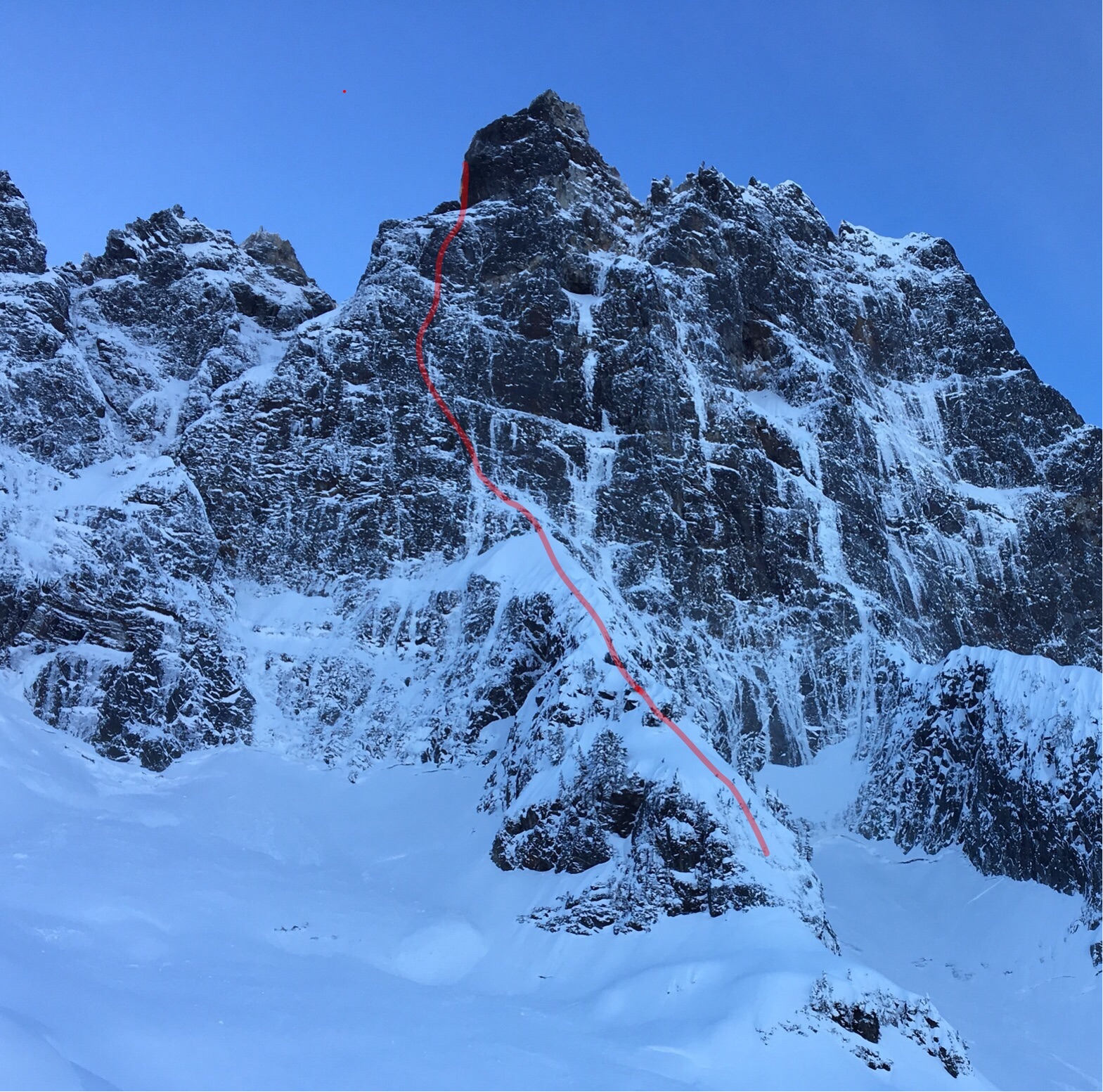 The red line shows the route taken by Marc-Andre Leclerc and Tom Livingstone on January 3 for the first winter ascent of the Navigator Wall on Canada's Mt. Slesse. They estimated the difficulties to be M7+ R or Scottish VIII or IV, according to Livingstone. [Photo] Marc-Andre Leclerc